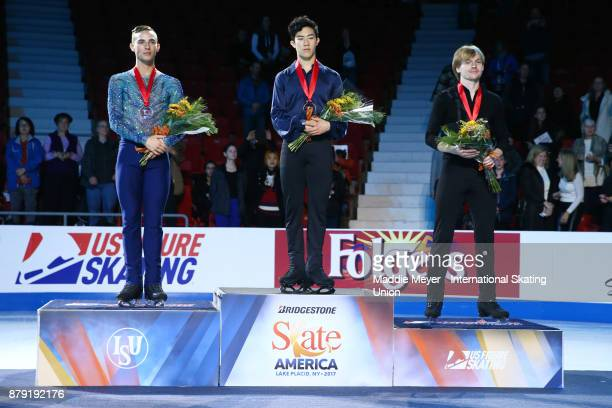 From left silver medalist Adam Rippon of the United States gold medalist Nathan Chen of the United States and bronze medalist Sergei Voronov of...