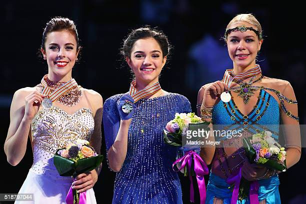 From left, silver medalist Ashley Wagner of the United States, gold medalist Evgenia Medvedeva of Russia, and bronze medalist Anna Pogorilaya of...