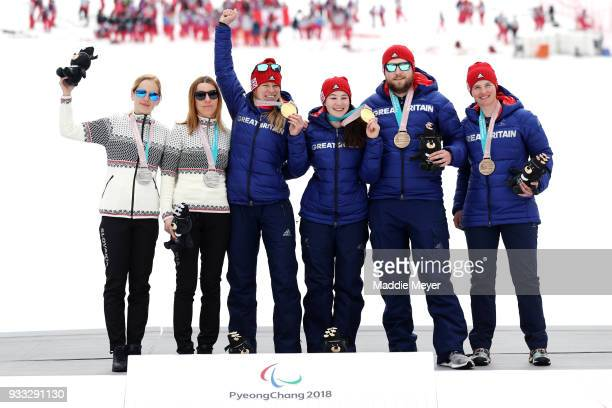From left silver medalist guide Natalia Subrtova and skier Henrieta Farkasova of Slovakia gold medalist guide Jennifer Kehoe and skier Menna...
