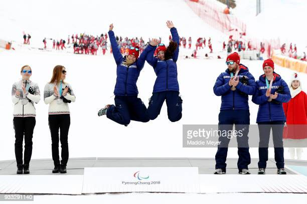 From left silver medalist guide Natalia Subrtova and skier Henrieta Farkasova of Slovakia gold medalist guide Jennifer Kehoe and skier Menna...