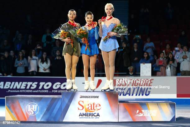 From left silver medalist Kaori Sakamoto of Japan gold medalist Satoko Miyahara of Japan and bronze medalist Bradie Tennell of the United States...