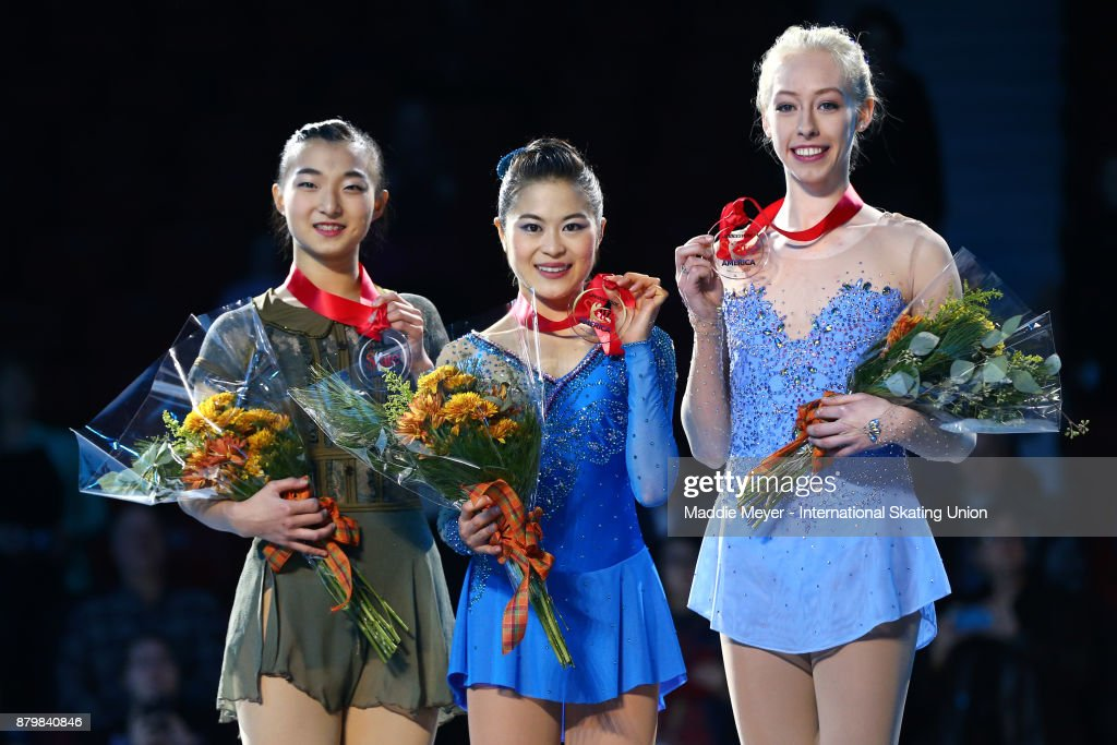 From left, silver medalist Kaori Sakamoto of Japan, gold medalist Satoko Miyahara of Japan, and bronze medalist Bradie Tennell of the United States receives their Ladies division awards on Day 3 of the ISU Grand Prix of Figure Skating at Herb Brooks Arena on November 26, 2017 in Lake Placid, United States.