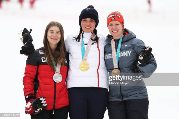 From left silver medalist Mollie Jepsen of Canada gold medalist Marie Bouchet of France and bronze medalist Andrea Rothfuss of Germany celebrate...