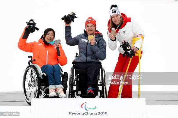 From left silver medalist Momoka Muraoka of Japan gold medalist AnnaLena Forster of Germany and bronze medalist Heike Eder of Austria celebrate...