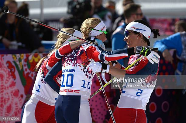 Silver medalist Norway's Therese Johaug bronze medalist Norway's Kristin Stoermer Steira and gold medalist Norway's Marit Bjoergen celebrate their...