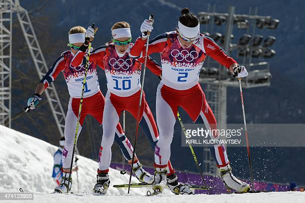 Silver medalist Norway's Therese Johaug bronze medalsit Norway's Kristin Stoermer Steira and gold medalist Norway's Marit Bjoergen compete in the...