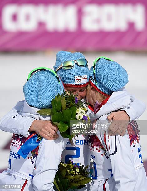 silver medalist Norway's Therese Johaug gold medalist Norway's Marit Bjoergen and bronze medalist Norway's Kristin Stoermer Steira celebrate at the...