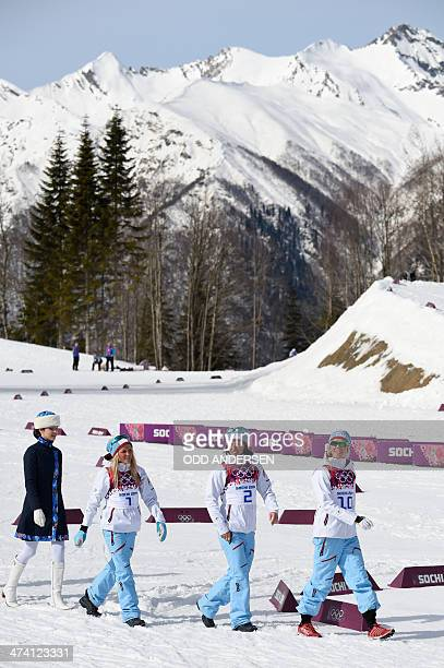 silver medalist Norway's Therese Johaug gold medalist Norway's Marit Bjoergen and bronze medalist Norway's Kristin Stoermer Steira make their way ot...