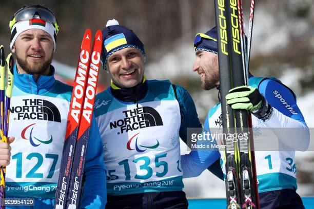 From left silver medalist Yury Holub of Belarus gold medalist Vitaliy Luk'yanenko of Ukraine and bronze medalist Anatolii Kovalevskyi of Ukraine...