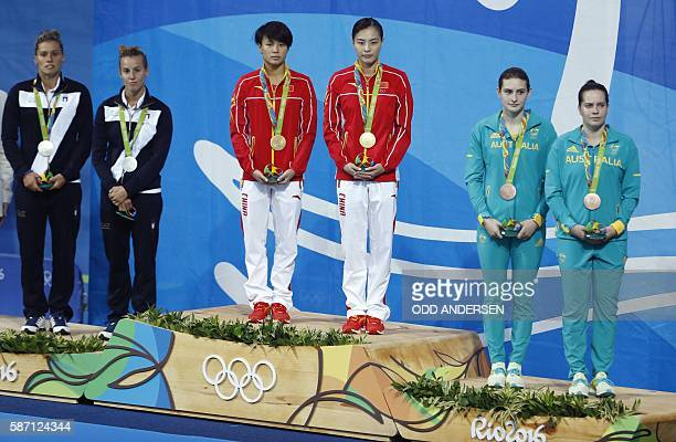 Silver medallists Italy's Francesca Dallape and Tania Cagnotto gold medallists China's Shi Tingmao and Wu Minxia bronze medallists Australia's...