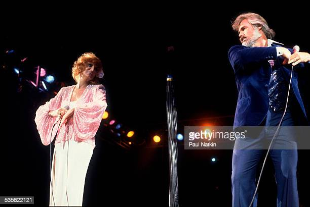 From left singer Dottie West and American musician Kenny Rogers perform at the Rosemont Horizon Rosemont Illinois May 17 1980