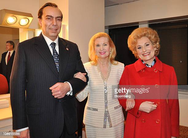 From left singer James Maddalena who portrays Richard Nixon Tricia Nixon and singer Janis Kelly who portrays Pat Nixon pose at the opening of Nixon...