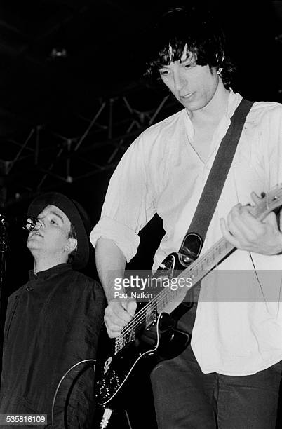 From left singer Michael Stipe and guitarist Peter Buck of the band REM perform on stage at McGaw Hall Chicago Illinois May 6 1985