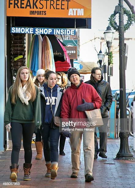 From left sisters Alison and Elisabeth Clark and their mom Lorna Clark of Yarmouth walk along Exchange Street in Portland on a Black Friday shopping...