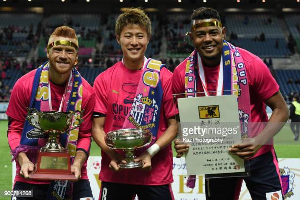 From left Souza Yoichiro Kakitani and Ricardo Santos of Cerezo Osaka hold Cups during the 97th All Japan Football Championship final between Cerezo...