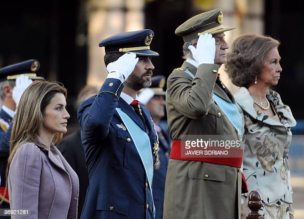 Spain's Princess Letizia her husband Prince Felipe King Juan Carlos and his wife Queen Sofia listen to the national anthem during National Day...