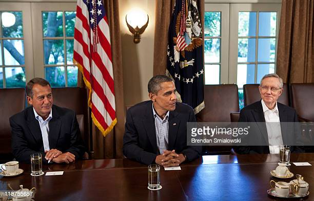 From left Speaker of the House John Boehner President Barack Obama and Senate Majority Leader Senator Harry Reid sit before a meeting in the Cabinet...