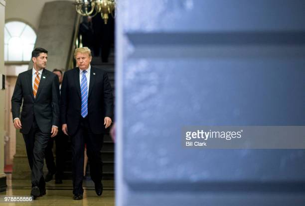 From left Speaker of the House Paul Ryan RWisc escorts President Donald Trump to the House Republican caucus meeting in the basement go the Capitol...