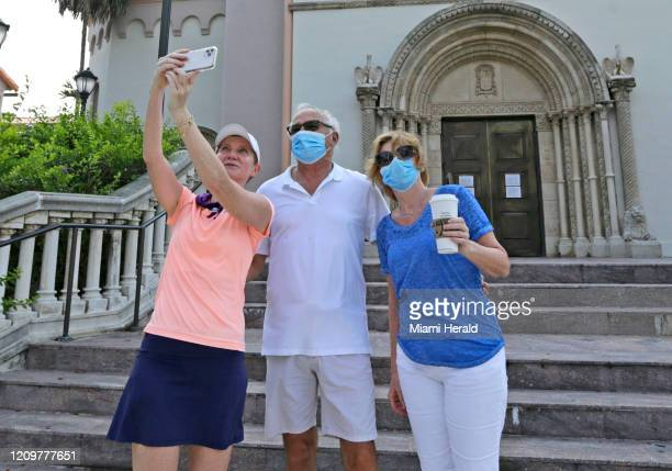 From left St Patrick Catholic Church congregants Holly Martin and Dianne Sheffield take a selfie on Easter Sunday as the novel coronavirus pandemic...