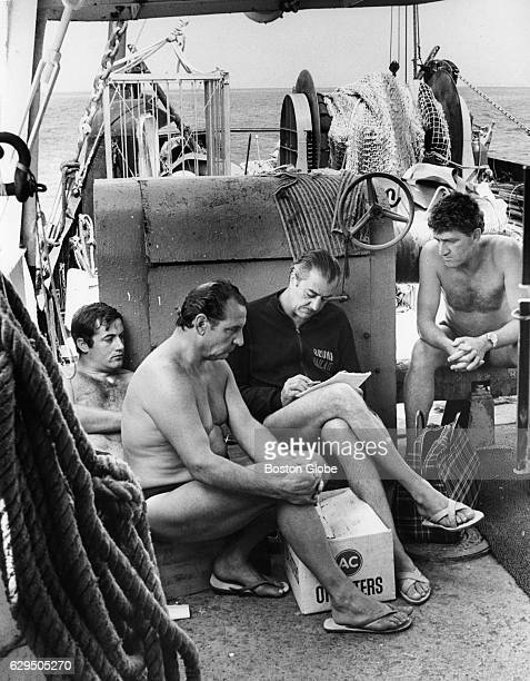 From left Stafano Carletti Arnolda Mattei Bruno Vallati and Cosmo Dies look over a map on board the Narragansett prior to diving on the Andrea Doria...