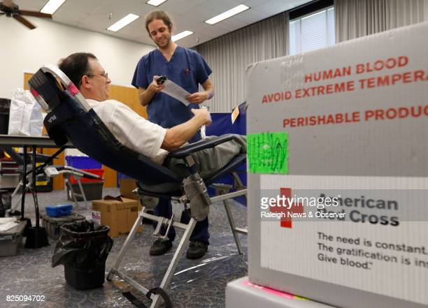 From left state employee David Wainwright gives identifying information to American Red Cross phlebotomist Chris Culpepper on Wednesday July 6 2016...