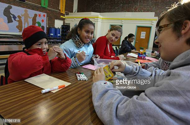 From left students George Castillo and sister Desteni Castillo prepare to make thank you cards under the tutelage of student volunteers Laura Boston...