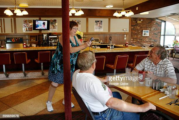 From left Susan Starbird of Hamden Maine takes pictures of brothers Ron and Tom Clark as she tries to document one of her last visits to the Howard...