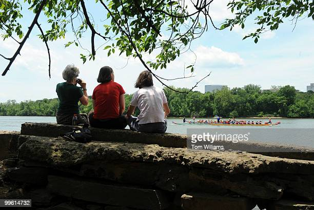 From left Susan Weld Alice Sturm and her daughter Joanna Sturm watch races from a bank on the Potomac River during the DC Dragon Boat Festival June 1...
