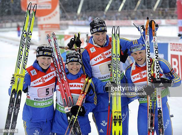 Sweden's Helena Jonsson Anna Carin OlofssonZidek Bjorn Ferry and Carl Johan Bergman celebrate they third place after the biathlon World Cup mixed...