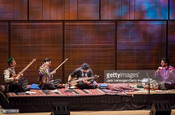 From left Tajik musicians Mukhtor Muborakqadimov on Badakhshani setar and Sirojiddin Juraev on dutar and Afghan emigres Homayun Sakhi on Afghan rubab...