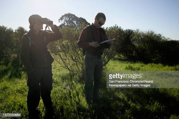 Teresa Feo and Chris Clark. Chris Clark takes notes and Teresa Feo takes notes while both are out near the Albany Waterfront Trail researching a...