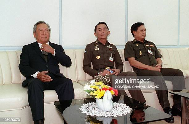 Thai Prime Minister Chatichai Choonhavan sits besides General Sunthorn Kongsompong the commanderinchief of the Thai army and Army Chief General...