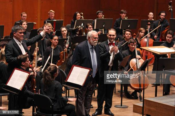 From left the conductor Alan Gilbert the composer Christopher Rouse and the flutist Giorgio Consolati with the Juilliard Orchestra at David Geffen...