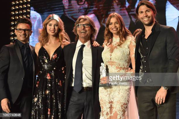 From Left the designer Gino Signore Miss Italia second choice Fiorenza D'Antonio italian gossip journalist Roberto Alessi Ivana MrázováCzech model...