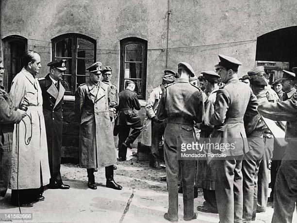 From left the former ministry Albert Speer the Reich grand admiral and chancellor Karl Doenitz and the general Alfred Jodl some minutes after their...