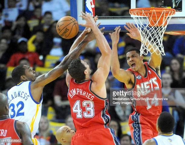 From left, The Golden State Warriors' Mickell Gladness , the New Jersey Nets' Kris Humphries and Gerald Green all try to catch a rebound in the first...