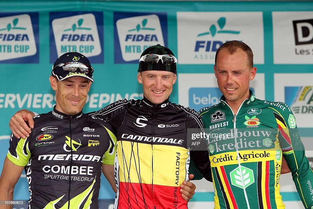 Third-placed Dutch cyclist Bas Peeters, winner Belgian Roel Paulissen and second-placed Belgian Sven Nys celebrate on June 6, 2010 on the podium after the third round of the Belgacom Belgian Mountain Bike Grand Prix in Verviers.