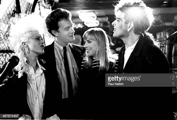 From left Thompson Twin member Alannah Currie actor Tom Hanks actress Bess Armstrong and Thompson Twin member Tom Bailey on the set of the Thompson...