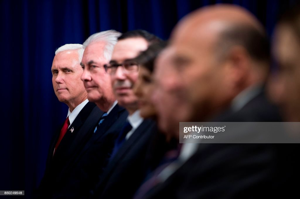 US Vice President Mike Pence, US Secretary of State Rex Tillerson, US Secretary of the Treasury Steven Mnuchin and others wait for a meeting on September 20, 2017 between US President Donald Trump and Britain's Prime Minister Theresa May at the Palace Hotel in New York, on the sidelines of the 72nd United Nations General Assembly. / AFP PHOTO / Brendan Smialowski