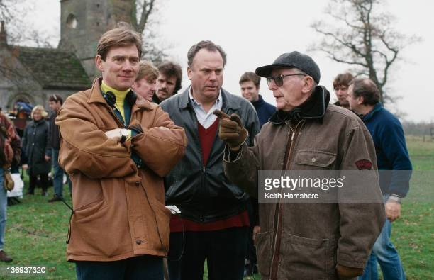 From left to right actor Anthony Andrews coproducer William P Cartlidge and director Lewis Gilbert on the set of the film 'Haunted' 1995