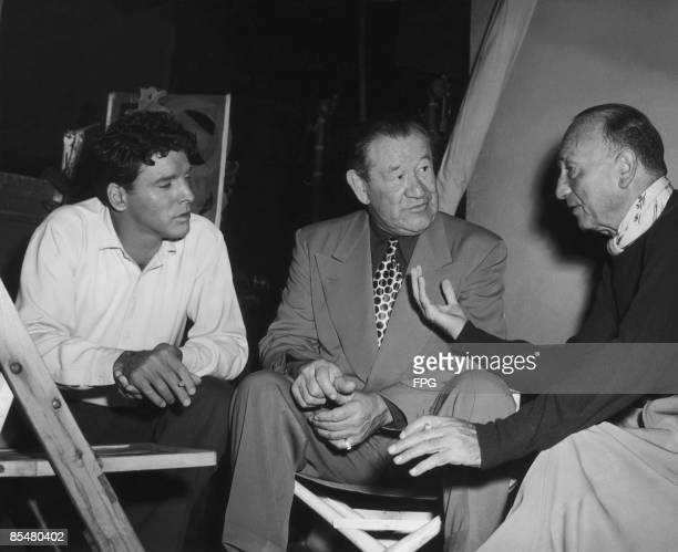 From left to right actor Burt Lancaster athlete Jim Thorpe and director Michael Curtiz on the set of the biopic 'Jim Thorpe AllAmerican' in Hollywood...