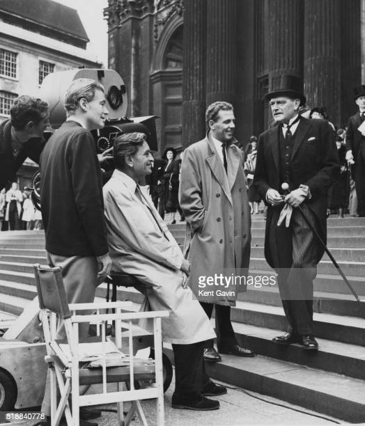 From left to right actor Peter O'Toole English film director David Lean and actors Jack Hedley and Jack Hawkins on the steps of St Paul's Cathedral...