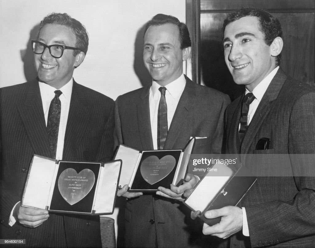 From left to right, actor Peter Sellers, David Jacobs and composer Lionel Bart holding awards belonging to Alfie Bass and Shirley Anne Field at the Variety Club awards luncheon at the Savoy Hotel, 14th March 1961. Sellers was voted Best Film Actor of 1960, and Bart was voted Show Business Personality of 1960.