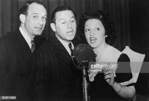 From left to right actor Vic Oliver actor Ben Lyon and his wife actress Bebe Daniels recording the BBC radio programme 'Hi Gang' 20th May 1941