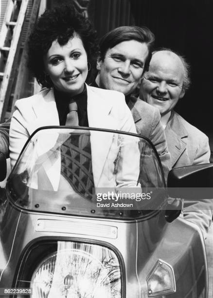 From left to right actors Adrienne Posta Nicky Henson and Roy Kinnear the stars of the new BBC2 consumer programme 'That's the Way the Money Goes'...