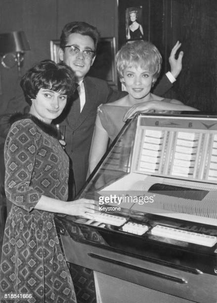 From left to right actors Agnes Varda Michel Legrand and Corinne Marchand at a reception at the Club SaintHilaire in Paris to mark the completion of...