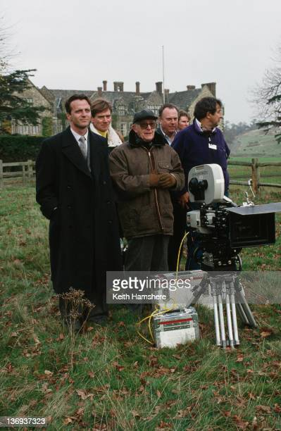 From left to right actors Aidan Quinn and Anthony Andrews director Lewis Gilbert coproducer William P Cartlidge and another crew member on the set of...