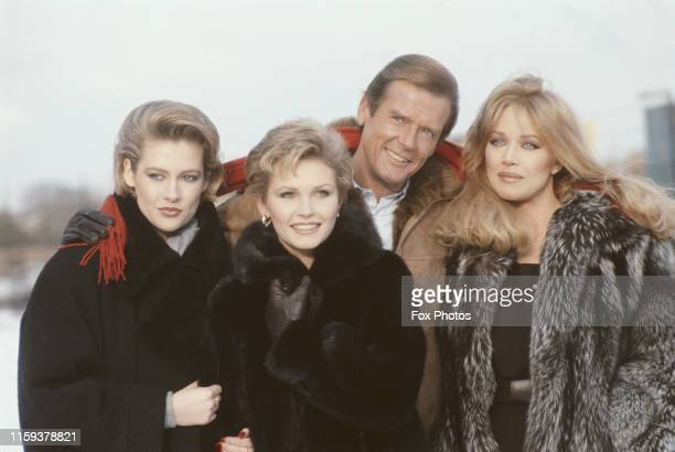 From left to right actors Alison Doody Fiona Fullerton Roger Moore and Tanya Roberts pose at Pinewood Studios in England to promote the new James...