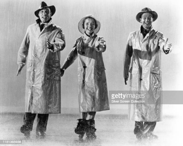 From left to right actors and singers Gene Kelly Debbie Reynolds and Donald O'Connor in the musical film 'Singin' in the Rain' 1952