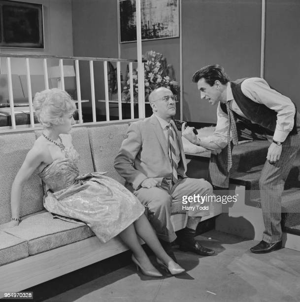 From left to right actors Ann Lynn Warren Mitchell and Alex Scott filming 'Time to Kill' an episode of the 'Suspense' series at the BBC studios in...